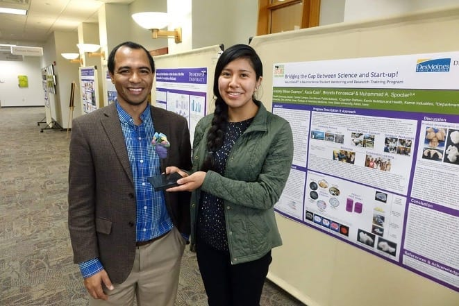 2019 DMU Research Symposium. Student Aracely Miron-Campo with Dr. Spocter showing a 3D printed model of the canid brainstem