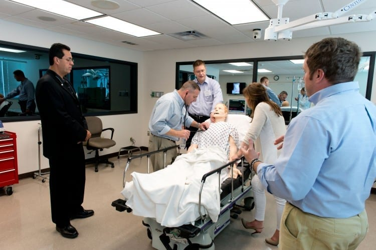 Alums inspect Harvey in Simulation Lab at 2014 Reunion