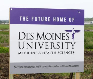 """Future Home of DMU"" sign"