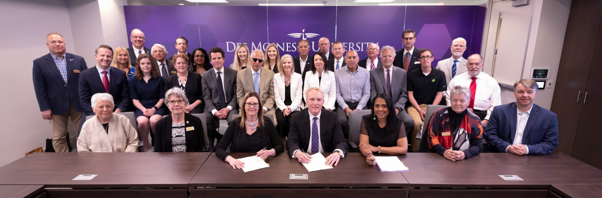 Signing of property agreement between the McKinney family and the DMU Board of Trustees