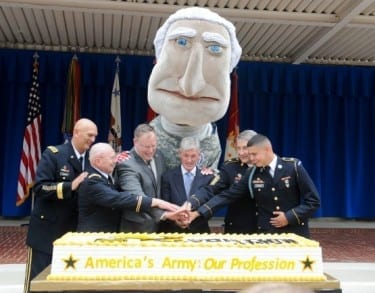 Col. Arthur Witch helps cut the cake at the Army's 239th birthday party.