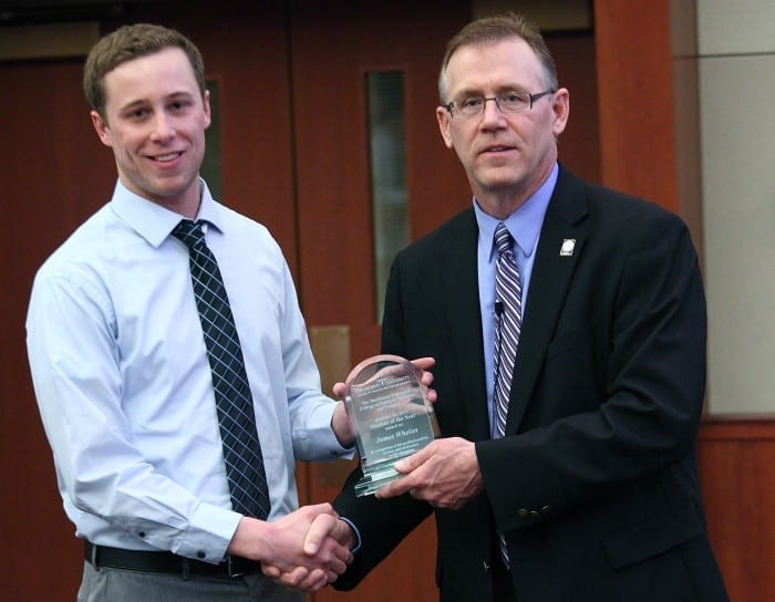 James Whelan, D.P.M.'14, receives the 2013 CPMS Student of the Year award from Dean Robert Yoho