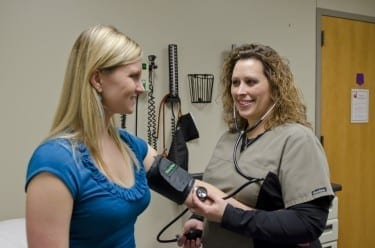 A patient gets her blood pressure checked at Des Moines University Clinic