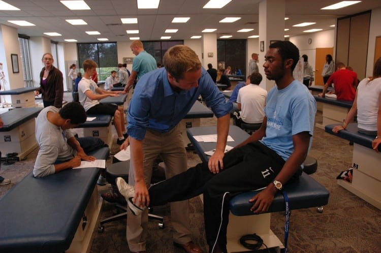 DMU's osteopathic medical students learn to apply osteopathic manual treatments to help patients heal and feel and perform better.