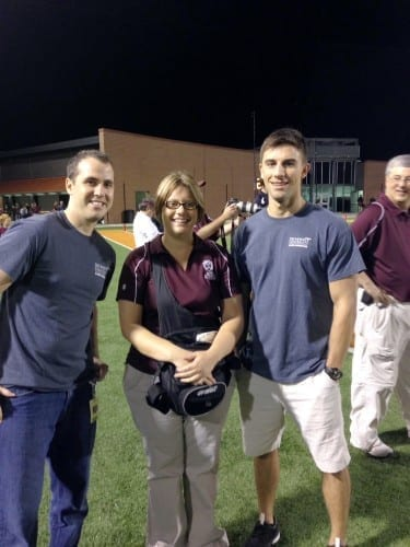 Riley L. Pett, D.P.M.'16 (left), and Andrew R. Bouwkamp, D.P.M.'17 (right), volunteer at high school football games