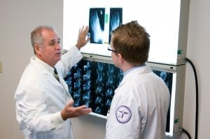 Dr. Mahoney examining an x-ray