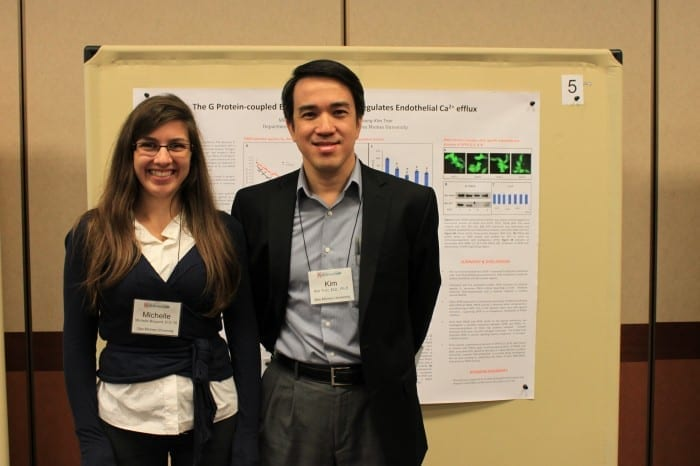 Michelle Burgard, D.O.'16, and stands with her mentor Kim Tran, M.D., Ph.D., in front of her award-winning poster