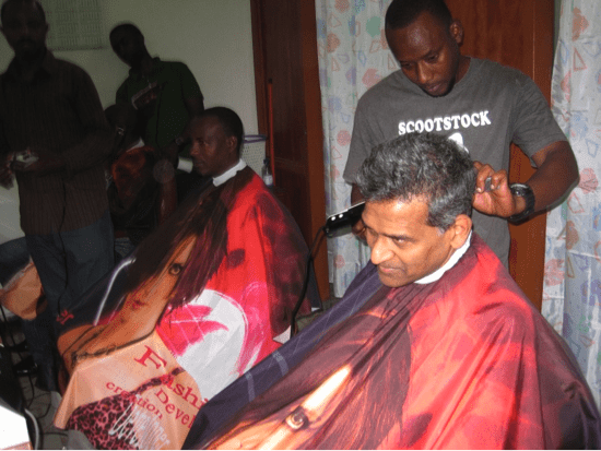 Dr. Shah's first haircut in Kigali (lucky him - he was his stylist's first non-Rwandan customer)