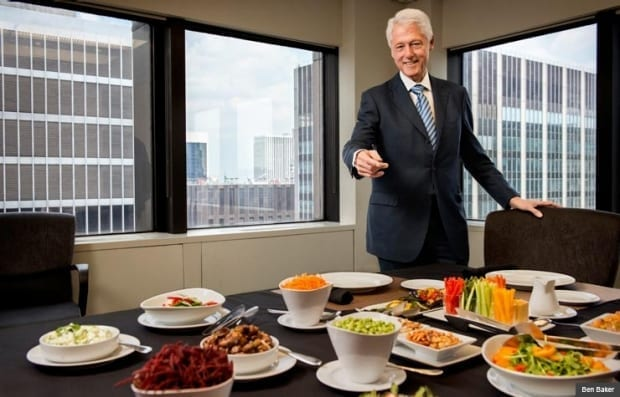Bill Clinton shows off an all-veggie lunch spread representing the foods he now eats, and enjoys. Photo: Ben Baker