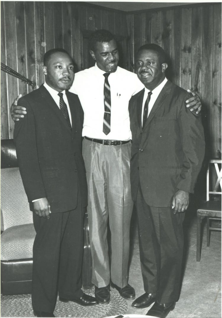 DMU grad William Anderson, center, with Martin Luther King Jr. and Ralph Abernathy in the Andersons' Albany, GA, home. From Autobiographies of a Black Couple of the Greatest Generation by Norma L. Anderson and William G. Anderson.