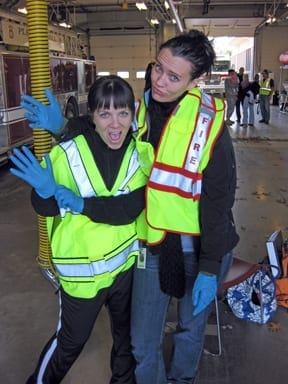Me & a classmate in our safety vests waiting for the next collection.
