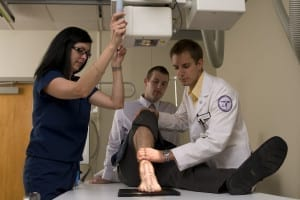 A patient receives a foot X-ray at Des Moines University Radiology.