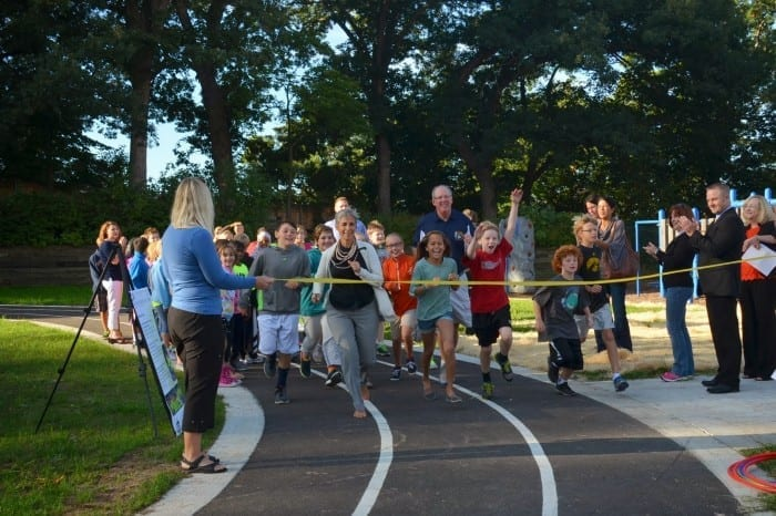Students and staff at Hanawalt Elementary break in their new track