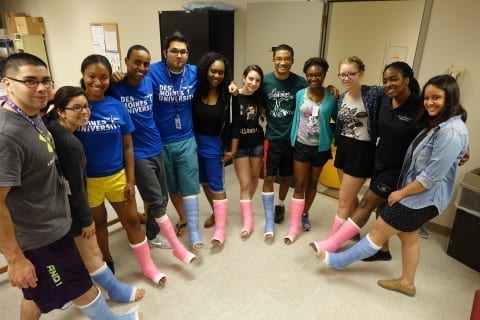 Health PASS students wearing leg casts