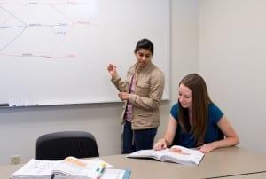 A peer tutor helps a student