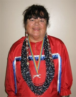 Glenna Ewing, in traditional Ho Chunk dress, at the seminar.