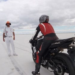 Pflum and friend Seth Hammond prepare Gustafson for a race. Pflum is astride the cycle on which she exceeded 190 mph.